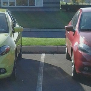 Darting Sisters...   How my best Friend and I park each day at work.  His is a 1.4L Turbo 6spd stock.